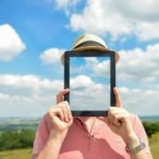 photo of a man holding an iPad