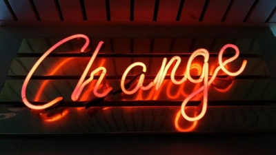 photo of a neon sign saying Change