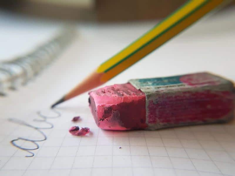 photo of a pencil and eraser