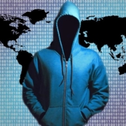 illustration of a hacker and a map of the world
