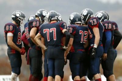 photo of a football huddle