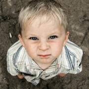 photo of an unhappy little boy