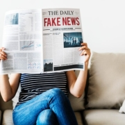 photo of a woman reading a newspaper