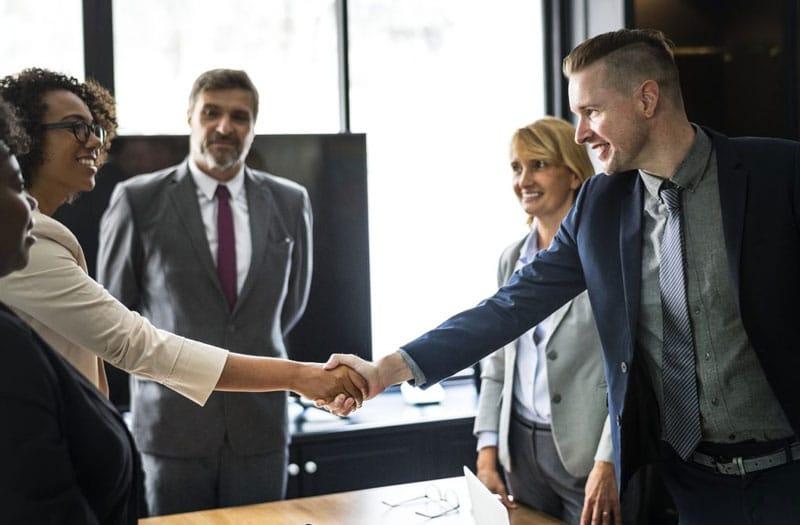 photo of sales representatives shaking hands